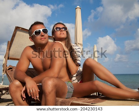Happy romantic couple enjoying beautiful sun at the beach. Romantic vacation in French Riviera. Travel holidays concept.  - stock photo