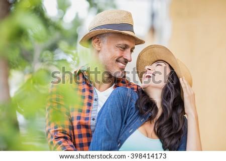 Happy romantic couple enjoying outdoors - stock photo