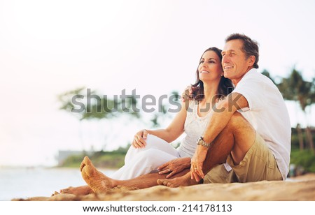 Happy Romantic Mature Couple Enjoying Sunset on the Beach - stock photo