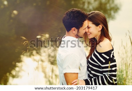 happy romantic sensual couple in love together outdoors on summer vacation - stock photo