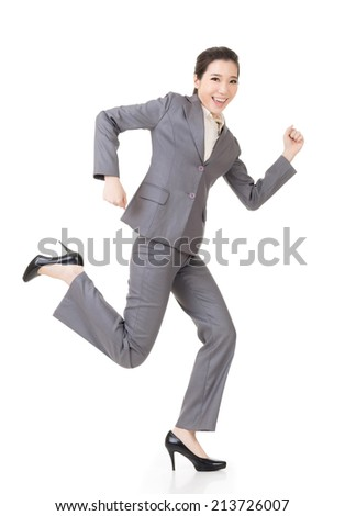 Happy running Asian businesswoman, full length portrait isolated on white background. - stock photo