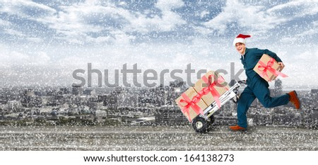 Happy Running Delivery postman with Christmas presents - stock photo