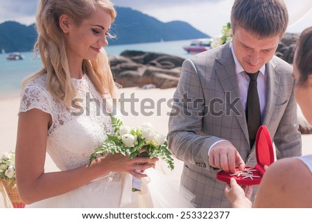 Happy Russian Couple in love on wedding ceremony seaside tropical beach thailand phuket arch European style - stock photo