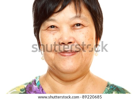 Happy 60s Senior Asian Woman on white background - stock photo