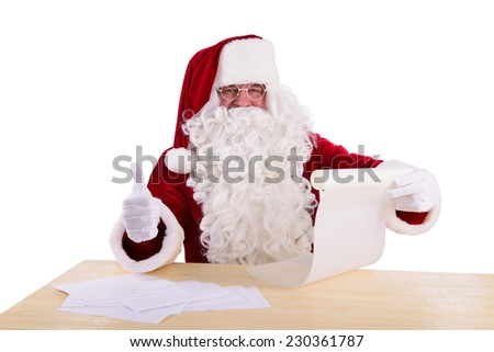 happy Santa Claus reading a letter. Isolated on white background - stock photo