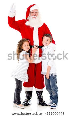Happy Santa Claus with a couple of kids - isolated over a white background - stock photo