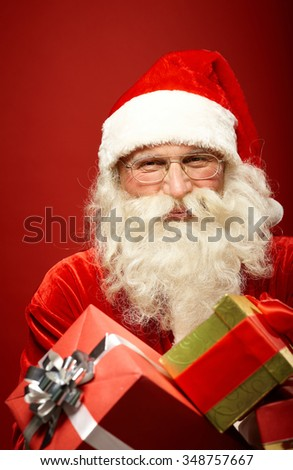 Happy Santa Claus with giftboxes - stock photo