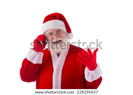 Happy Santa talking on his smartphone - stock photo