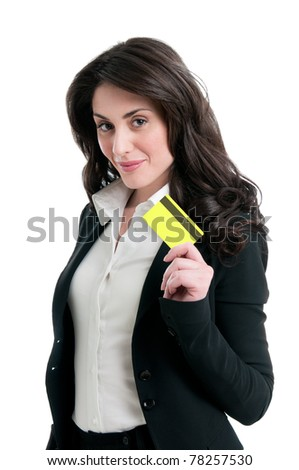 Happy satisfied business woman holding and showing her credit card isolated on white background - stock photo