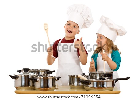 Happy satisfied chef and his aid - kids with cooking utensils, isolated - stock photo