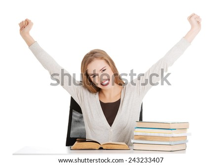 Happy, satisfied young student woman with stack of books. isolated on white. - stock photo