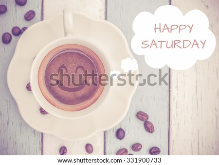 Happy Saturday with coffee cup on table   - stock photo