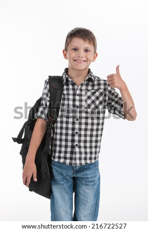 Happy schoolboy wearing backpack and giving thumbs up. cute schoolboy standing isolated on white background - stock photo