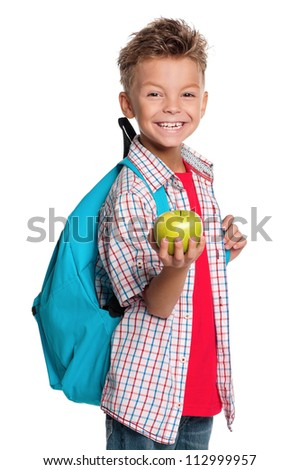 Happy schoolboy with backpack and apple isolated on white background - stock photo