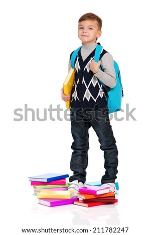 Happy schoolboy with backpack and books isolated on white background - stock photo