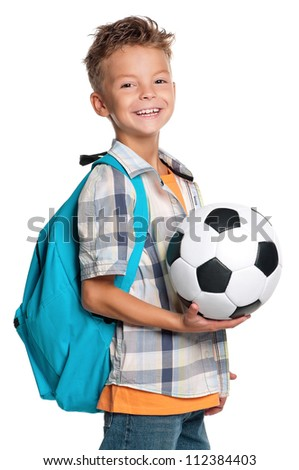 Happy schoolboy with backpack and soccer ball isolated on white background - stock photo
