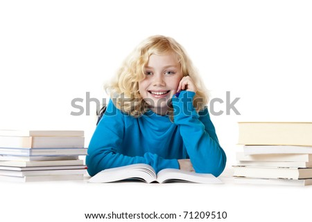 Happy schoolgirl lying on floor doing homework. .Isolated on white background. - stock photo