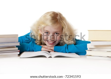 Happy schoolgirl lying on floor learning for school .Isolated on white background. - stock photo