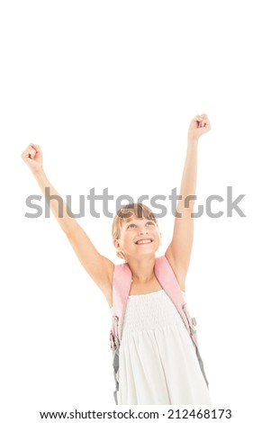 Happy schoolgirl with arms up. - stock photo