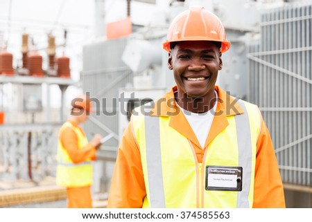 happy senior african american technical worker in substation - stock photo