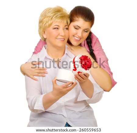 Happy senior and young woman isolated - stock photo