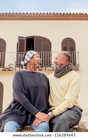 happy senior couple after emigrating  - stock photo