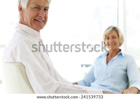 Happy senior couple at home - stock photo