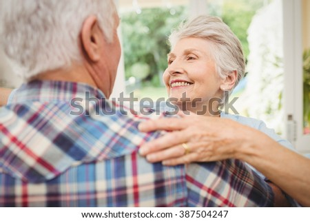 Happy senior couple dancing at home - stock photo