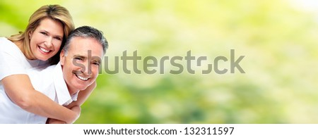 Happy senior couple. Elderly people outdoors. - stock photo