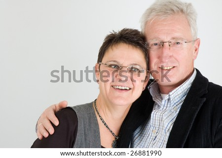Happy senior couple holding each other - stock photo
