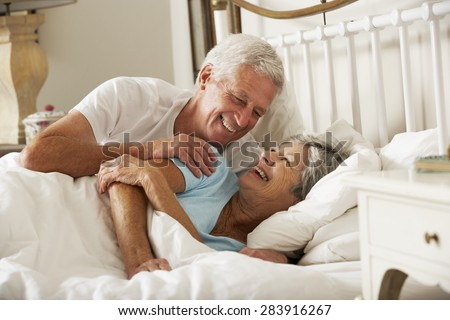 Happy Senior Couple In Bed Together - stock photo