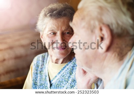 Happy senior couple in love inside of their house - stock photo