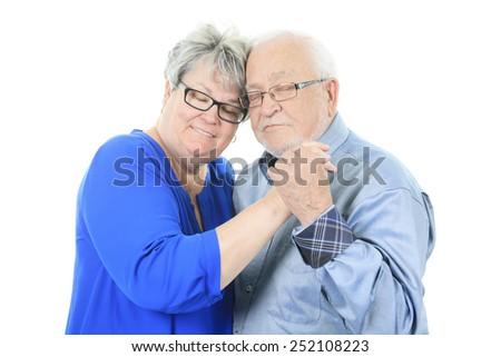 Happy senior couple in love. Isolated over white background - stock photo