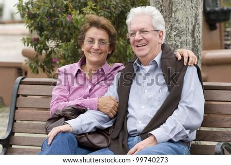 Happy Senior Couple In The Park Otdoor - stock photo