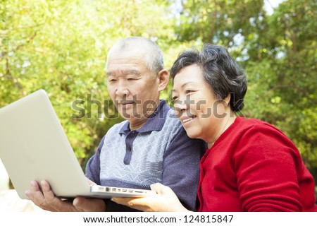happy  Senior couple learning with laptop - stock photo