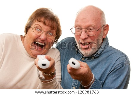 Happy Senior Couple Play Video Game with Remote Controls On a White Background. - stock photo