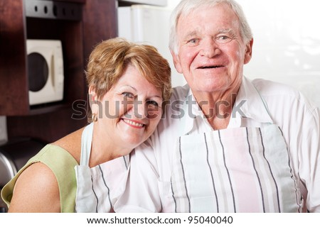 happy senior couple portrait in home kitchen - stock photo