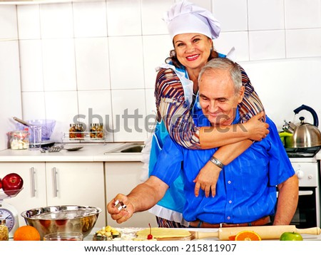 Happy senior family cooking at kitchen. - stock photo