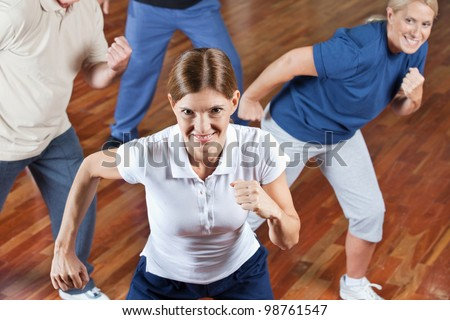 Happy senior group dancing in fitness center class - stock photo