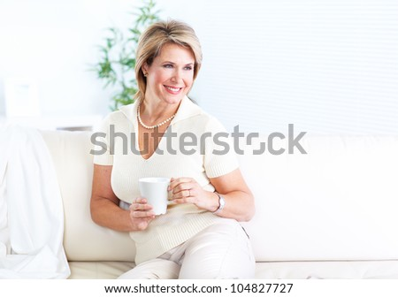 Happy senior healthy woman relaxing at home. - stock photo