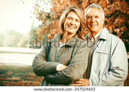 Happy senior loving couple over park nature background - stock photo
