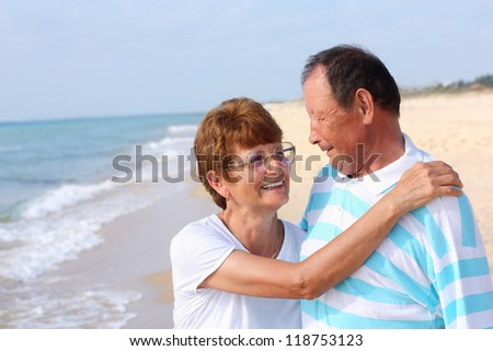 Happy senior man and woman couple together - stock photo