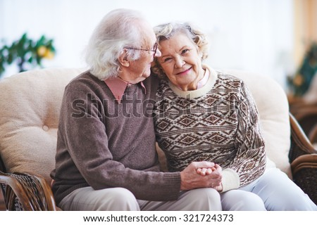Happy senior man and woman having rest at home - stock photo