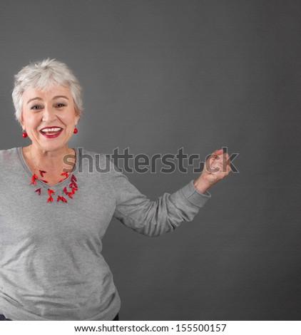 Happy senior woman celebrating success - stock photo