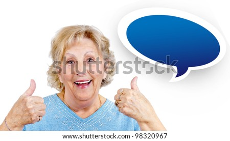 Happy senior woman giving two thumbs up as sign of approval. - stock photo