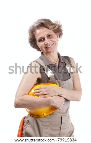 Happy senior woman holding a safety hat (isolated on white) - stock photo