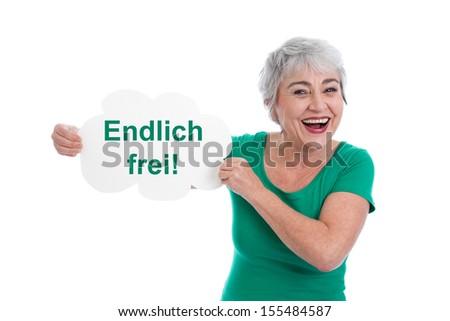 Happy senior woman holding Finally free sign - stock photo