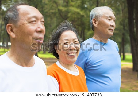 happy senior woman looking at camera with her brothers - stock photo