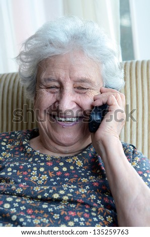happy senior woman on phone - stock photo