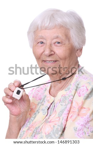 Happy Senior woman wearing a medical emergency panic button pendant  - stock photo